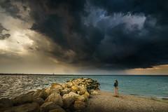 Storm (Adrian Mitu) Tags: blue sky clouds storm weather sea rocks woman human sand seashore romania