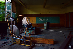 Shown In The Classroom (jna.rose) Tags: abandoned urbandecay school urbex urbanexploration exercise machine shown words board chalkboard class head doll toy old debris decaying derelict nikon workout d5300 naturallight