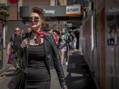 A Certain Vintage (Leanne Boulton) Tags: people urban street candid portrait portraiture streetphotography candidstreetphotography candidportrait streetportrait eyecontact candideyecontact streetlife woman female girl face look emotion mood feeling style stylish fashion vintage leather jacket red sunglasses tone texture detail depthoffield bokeh naturallight outdoor sunlight light shade shadow city scene human life living humanity society culture lifestyle canon canon5d 5dmkiii 70mm ef2470mmf28liiusm color colour glasgow scotland uk