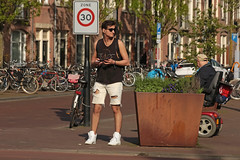 Javaplein - Amsterdam (Netherlands) (Meteorry) Tags: europe nederland netherlands holland paysbas noordholland amsterdam amsterdampeople candid streetscene people oost east est indischebuurt zeeburg javaplein javastraat guy male homme hunk cute sunglasses boy twink jeans short peace zone30 sign sneakers trainers baskets skets bikes vélos bicyclettes bicycles legs jambes dutch april 2018 meteorry