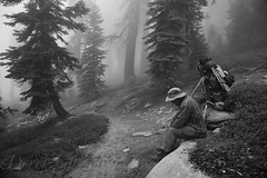 Wilderness Wanderer (photography by Derek G) Tags: wildernesswanderer wilderness wandering backpacking camping hiking resting forest mist fog cloulds rain trees trail path sitting landscape blackandwhite highsierra jennielake sequoia kingscanyon california portrait