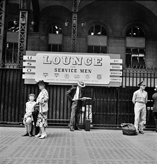 Waiting for trains at the Pennsylvania railroad station, New York. August 1942. (polkbritton) Tags: 1940s marjorycollins pennstation wwiihomefront vintagefashion fsaowi libraryofcongresscollections worldwarii newyorkcity newyorkhistory
