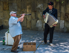 2018 - Bulgaria - Veliko Târnovo - Buskers (Ted's photos - For Me & You) Tags: 2018 bulgaria cropped nikon nikond750 nikonfx tedmcgrath tedsphotos vignetting buskers two duo deux males entertainers musicians accordian horn clarinet bottle onebottle ballcap box cardboardbox tipbox keyboard beerbottle