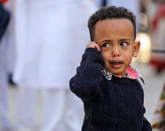 "A slang phrase in Israel says: ""When I was born, I cried. When I reached the army I understood why"" (ybiberman) Tags: israel jerusalem ethiopianchurch ethiopiancathedral wedding boy crying portrait candid streetphotography people"