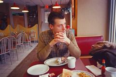 (Džesika Devic) Tags: film retro portrait vintage slidefilm 35mm analog contax man boy male husband boyfriend editorial sweater cinematic diner restaurant breakfast brunch