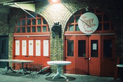 Miss Poppy Cakes Cafe (goodfella2459) Tags: nikon f4 af nikkor 50mm f14d lens cinestill 800t 35mm c41 film analog night miss poppy cakes cafe shop camden town markets london building light sign manilovefilm