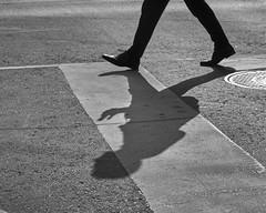 Crossroad #460 (azhukau) Tags: street people outdoors humanleg blackandwhite asphalt road men urbanscene oneperson walking blackcolor humanfoot males pedestrian youngadult adult citylife crossing shoe shadow