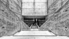 Down to the Metro (Leipzig_trifft_Wien) Tags: leipzig sachsen deutschland de architecture modern contemporary concrete subway underground station public urban transport black white bnw blackandwihite lines vanishing pov perspective stairs staircase