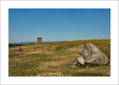 Between a rock & a hard place (prendergasttony) Tags: tower cage tonyprendergast nikon d7200 landscape people red sky outdoors rock hunting lodge lancashire cheshire blue couple vacation relax sitting three jail skyline