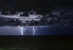 Out of The Blue (lightonthewater) Tags: lightning lightonthewater storm sand thunderstorm clouds cloudy ocean gulfofmexico santarosabeach florida floridathunderstorm flashlight