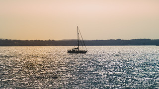 Silhouetted Sailboat on the Solent