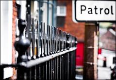 Patrol (G. Postlethwaite esq.) Tags: dof derbyshire fencefriday hff wirksworth bokeh depthoffield fence fullframe photoborder photowalk selectivefocus sign street town