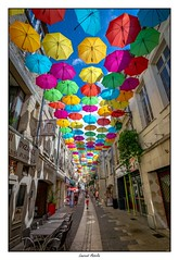 Umbrella sky project (Laurent Asselin) Tags: umbrella parapluies couleurs rue street art streetart artiste culture installation laon france
