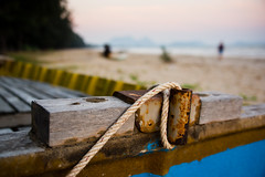 Rope tied to a fishing boat on the beach on sam roi yot, Thailand (BryonLippincott) Tags: thailand tourist asia asian southeastasia dolphinbay samroiyot beach boat sand fishing island ocean water fiberglass trees morning early goldenhour rope tied wood tambonsamroiyot changwatprachuapkhirikhan th
