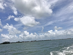 Boating Under the Clouds in Sarasota (soniaadammurray - On & Off) Tags: iphone sea sky clouds wake trees land boating boats architecture sarasota florida usa artchallenge exterior nature martedidinuvole martesdenubes nicewonderfultuesdayclouds