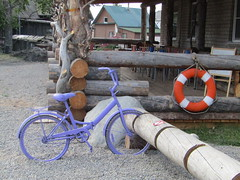 a nice lilac bike (VERUSHKA4) Tags: nord canon europe russia arkhangelskyregion solovetskyislands decoration village house cafe wooden vue view round july summer summertime window bicycle day chair lilac orange lifebuoy northerneurope wheel