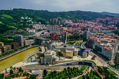 Museo Guggenheim from Iberdola Tower (Joshua Mellin) Tags: bilbao spain basquecountry basque euskadi paisvasco river bilbo guggenheim guggenheimbilbao museoguggenheim europe best culinary iberdola iberdolatower spanish espana visitespana visitspain tourism travel writer blogger photographer photo aerial pic pictures building rooftop 2018 summer july hot bilbaoriver museum european clean wonderful beautiful magical dreamlike heaven city heavenly bright sunny clear weather perfect perfection pleasant happy guggenheimmuseum guggenheimmuseumbilbao museoguggenheimbilbao bridge red green lush trees buildings architecture frankgehry architect masterpiece art artistic museo puppy lake outside outdoors
