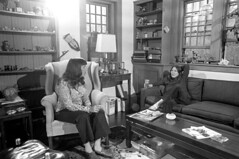 040571 15 (ndpa / s. lundeen, archivist) Tags: nick dewolf nickdewolf blackwhite monochrome blackandwhite 35mm film photographbynickdewolf bw april 1971 1970s boston massachusetts beaconhill familyhome 3mtvernonsquare people socialgathering livingroom seated sitting woman women brunette longhair couch sofa maggie chair easychair lamp table coffeetable windows books folders mask shelves youngwoman may