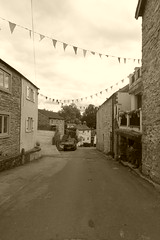 The Bank, Stoney Middleton    July 2018 (dave_attrill) Tags: thebank bunting stoneymiddleton derbyshire peakdistrict village eyam nearcalver ancient highway limestone limestoneburning industry besom bootmaking candle romansettlement lorddenman july 2018 sepia monochrome tint