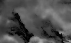 Au Pays des Nymphes de Lumière 1/2 (Frédéric Fossard) Tags: landscape snow glacier sky monochrome texture noiretblanc blackandwhite nuages clouds mist fog storm brume brouillard orage lumière light ombre cimes crêtes arêtes contraste silhouette mountainside flancdemontagne picdemontagne mountainridge mountainrange alpes hautesavoie montagne mountain aiguilledumidi massifdumontblanc antenne téléphérique aiguillerocheuse chamonix montblanc alpenglow altitude sérac hautemontagne