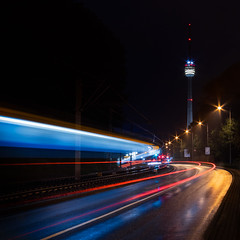 Hope and Fear (b.adolphi) Tags: lighttrails night stuttgart germany blue pink yellow tower reflection wet train car road