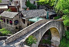 Crooked Bridge, Mostar (Jocelyn777) Tags: stone stonehouses cobblestones bridge crookedbridge ottoman ottomanarchitecture architecture buildings trees foliage towns villages historictowns sites monuments historicsites mostar bosniaandherzegovina balkans travel