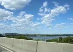 Montreal Island (Lou Musacchio) Tags: travel landscape urbanlandscape montrealisland mercierbridge sky water clouds concrete montreal quebec canada