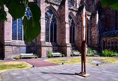 Beyond Limitations (rustyruth1959) Tags: nikon nikond5600 tamron16300mm uk england herefordshire hereford herefordcathedral cathedral architecture sculpture beyondlimitations garden ladyarbourgarden church religiousbuilding outdoor windows arches tree leaf flowers paving stainedglass bench seating sunshine metalwork