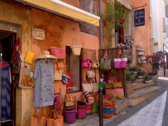 Roussillon (xtinab0s) Tags: provence summer colors ochre legend architecture street shop hat bag plants france roussilon