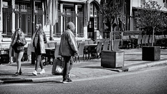 The Hairy And The Hooded (Alfred Grupstra) Tags: blackandwhite people street urbanscene outdoors city sidewalk citylife architecture women buildingexterior usa cultures editorial old walking town men history oldfashioned hairy hooded
