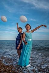 On the Shore (Duncan Lawler) Tags: talula isabella portsmouth southsea seaside whitebaloon childmodel children bluedress sea pebbles hampshire uk england kids