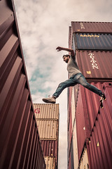 Jump // Hamburg (//Sebastian) Tags: hamburg germany harbor container jump leap parcour parcours run sport high height running sky blue industry industrial man risk dare