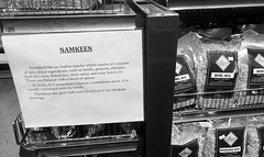 At the Indian Market (Melinda Stuart) Tags: sign vik'schaat india food snacks viks package grocery indian spice store monochrome namkeen