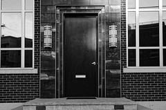 deco door (fallsroad) Tags: tulsaoklahoma city urban eastvillage blackandwhite bw monochrome architecture building door
