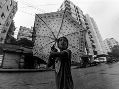 Dhaka Street #192 Another Monsoon (سلطان محمود) Tags: dhaka dhakastreet999 bangladesh i had exam today was rush but then rain hit she amazed for something dont know monsoon girl umbrella xiaomi yi action wide blackwhite baby rainy outdoor season monochrome street