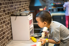 Portrait of a baby boy playing with toys in toy kitchen (Yinjia Pan) Tags: 23years chinaeastasia loveemotion portrait shanghai babyclothing beautifulpeople blackeye blackhair carefree casualclothing cheerful child childhood chineseethnicity concentration curiosity cute domesticlife enjoyment exploration family happiness indoors innocence joy kichen leisureactivity lifestyles partof photography playful playing sideview simpleliving toy