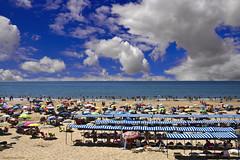 The beach * (ricardocarmonafdez) Tags: beach playa seascape seashore shoreline shore orilla mar sea arena sand sombrillas umbrellas cielo sky nubes clouds azul blue color light contrast contraste sunlight people 60d canon 1785isusm