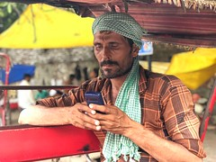 The Still Life of a Rickshaw Puller's Mobile Phone (Mayank Austen Soofi) Tags: the still life rickshaw puller's mobile phone