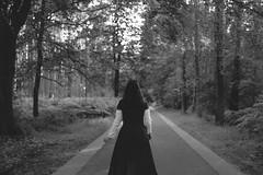 on the road (Lobe occipital) Tags: road route path chemin woman conceptual concept 50mm blackandwhite bw black white lasne belgique brabant wallon portrait dark emotion sadness future trees tree forest bokeh