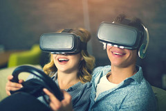 Couple having fun playing with VR - Credit to https://www.lyncconf.com/ (nodstrum) Tags: technology tech game gaming virtualreality reality augmentedreality oculusrift oculus future headset industry immersive