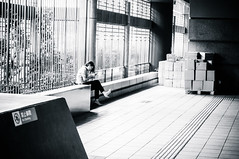 Woman reading - Jiantan MRT Station - Taipei, Taiwan (BryonLippincott) Tags: red taipei taiwan taiwanese asia asian city urban mrt masstransit publictransportation lightrail station woman sitting alone reading quiet peaceful heels fashionable blackandwhite documentary candid