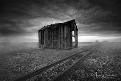 s h a c k . . . (Mark Leader) Tags: dungeness shack hut cabin kent fog mist coast beach rails pebbles shingle ruin decay