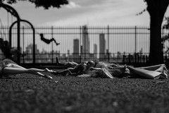 Toys, swings and Spider-Man. (Livia Lopez) Tags: toys playground blackandwhite blancoynegro noiretblanc city skyline shallowdepthoffield jugetes parque ciudad biancoenero swings trees arboles newyorkcity canon photography 35mm canon700d spiderman dolls