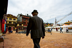 Man in a suit and hat walking around Boudhanath Stupa in Kathmandu, Nepal (BryonLippincott) Tags: nepal boudhanathstupa asia centralasia religion temple kathmandu tibetan prayerwheel cylindrical sanskrit nepalese nepali asian southernasia inside indoors day daytime travel destination tradition traditional culture heritage religious hindu hinduism spirituality interior old ancient building architecture exterior facade buddhist buddhism stupa monument man suit hat