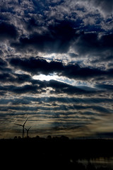 Blue Rays (alan.irons) Tags: light rays raysoflight sunrays sunlight silhouette clouds contrast bluelagoon water lake windturbines