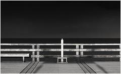 In der Ferne liegt die Kraft (tuthuyde) Tags: bridge sky meer sea ostsee binz abend winter light black white