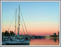 Rosy Calm (FernShade) Tags: vancouverbc coalharbour sunset sunsetcolors sky yachts scenery scenic seascape boat city water sea harbor marine