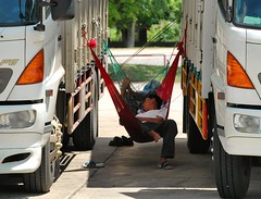 Time to take a nap (Steve4343) Tags: steve4343 nikon d70s thailand truck drivers drive truckers time take nap northeast khon kaen red yellow white green blue tree trees tire tires concrete