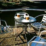 Table, chairs and disposable coffee cups thumbnail