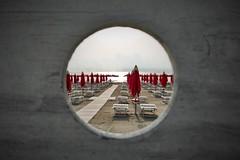 ombrelloni rossi (N I C K ....1 8 2 8) Tags: mare sea sole sun sony sonyxa2cameraphone red rosso cupramarittima ombrelloni
